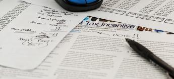 Steuern sparen durch Einsatz einer Immobilien GmbH und Holding Gesellschaft